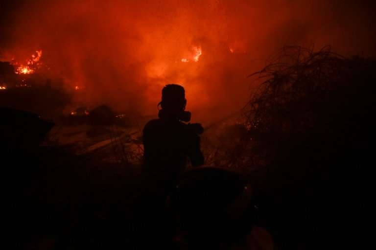 More than 100 Spanish firefighters, similar to this one pictured in October 2017, are tackling a wildfire that threatens one of