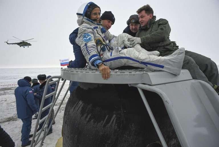 NASA astronaut Joe Acaba is helped out of the Soyuz MS-06 space capsule