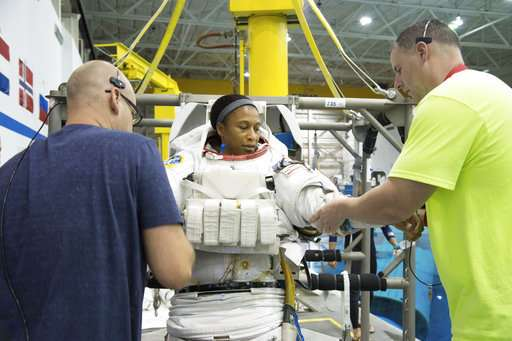 NASA bumps astronaut off June spaceflight in rare move