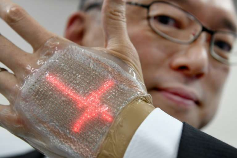 Palmreading could take on a whole new meaning thanks to a new invention from Japan: an ultra-thin display and monitor that can b
