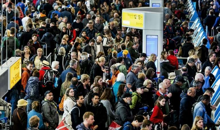 Passengers wait patiently after a power cut forced authorities to close Amsterdam's Schiphol Airport, one of Europe's busiest, f
