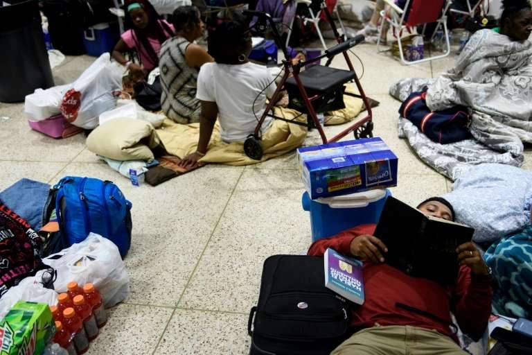People seek safety in a shelter as Hurricane Michael approaches Panama City, Florida
