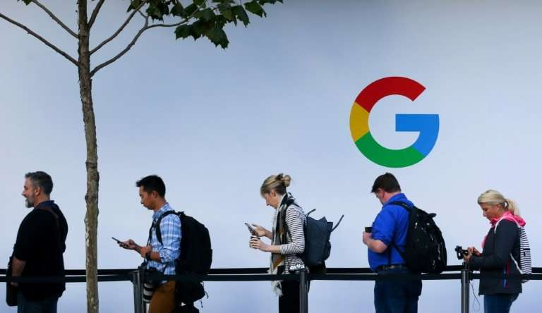 People wait in line to enter a Google product launch event in San Francisco, California