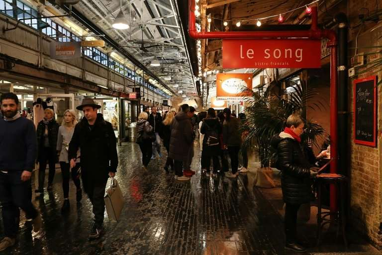 People walk through the Chelsea Market building in New York City, which was bought by Google for $2.4 billion