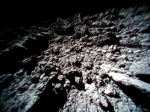 Photos from Japanese space rovers show asteroid is ... rocky