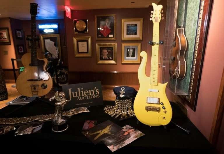 """Prince's custom-made """"Yellow Cloud"""" guitar sold for $225,000 in New York"""