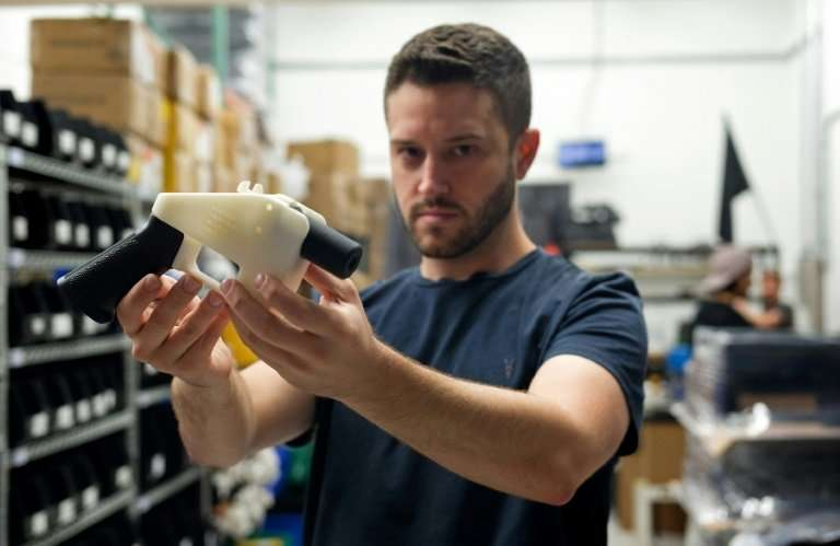 """""""No matter how badly I win or lose, you can download a gun from the internet,"""" Cody Wilson told AFP at the headquarter"""