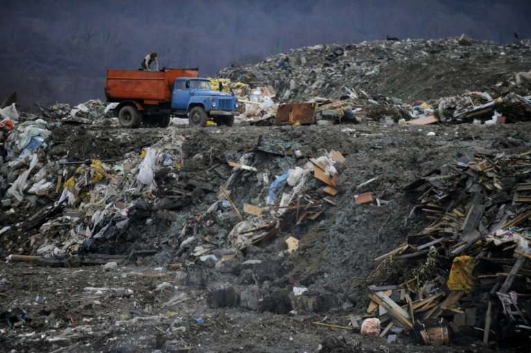 Rubbish is unloaded at a landfill site in Russia, where protests have been growing over the stench of decaying waste