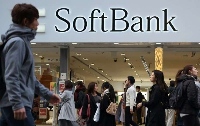 Shares in SoftBank's mobile unit rebounded after steep early declines on a rollercoaster second trading day Thursday