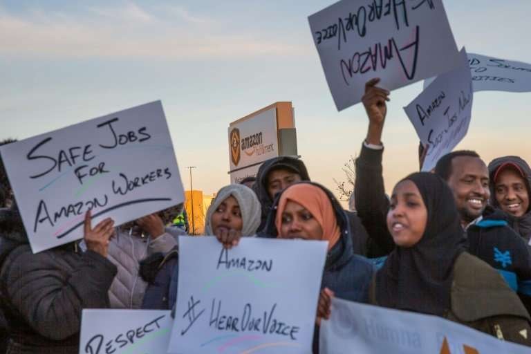 Somali-American Amazon workers demanding better working conditions protest at the the company's fulfillment center in Shakopee,