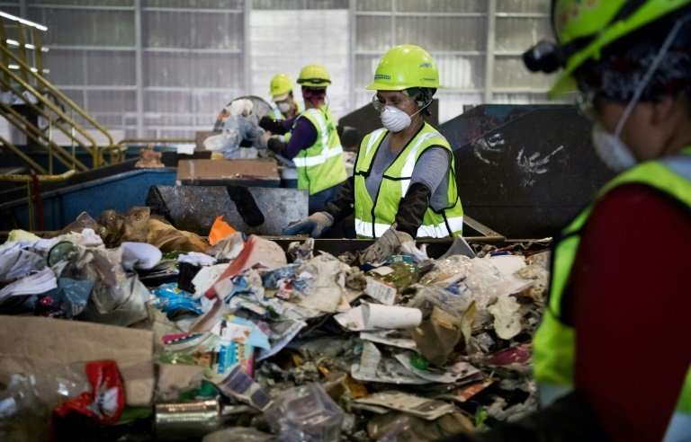 """Some workers must go through the recyclables by hand to remove items seen as """"contaminants"""""""