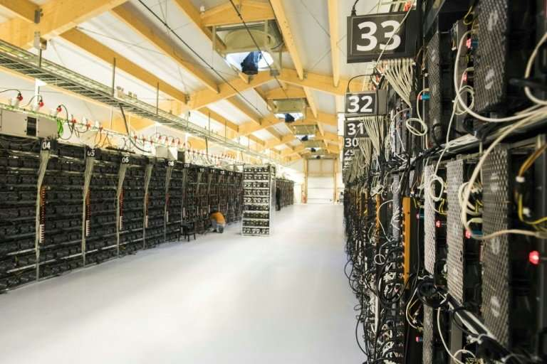 Souped-up computers called mining rigs operate 24/7, using huge amounts of electricity and generating lots of heat
