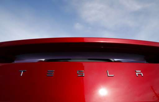 Tesla cuts 9 pct. of workforce in bid to post a profit