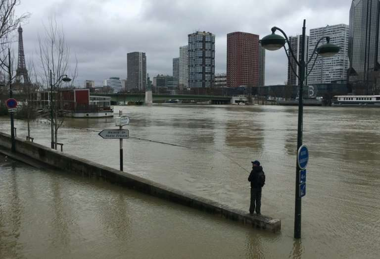 The flooding has caused headaches for commuters as well as people living near its overflowing banks