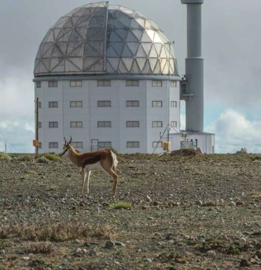 The optical telescope is housed in a white dome-shaped building made of carbon fibre to protect it against temperature fluctuati