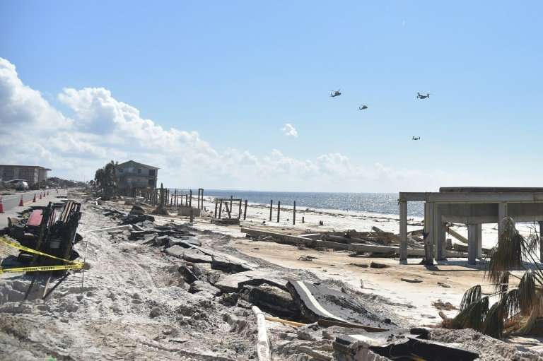 The presidential helicopter Marine One is seen flying along with Osprey planes over the areas destroyed by Hurricane Michael, in