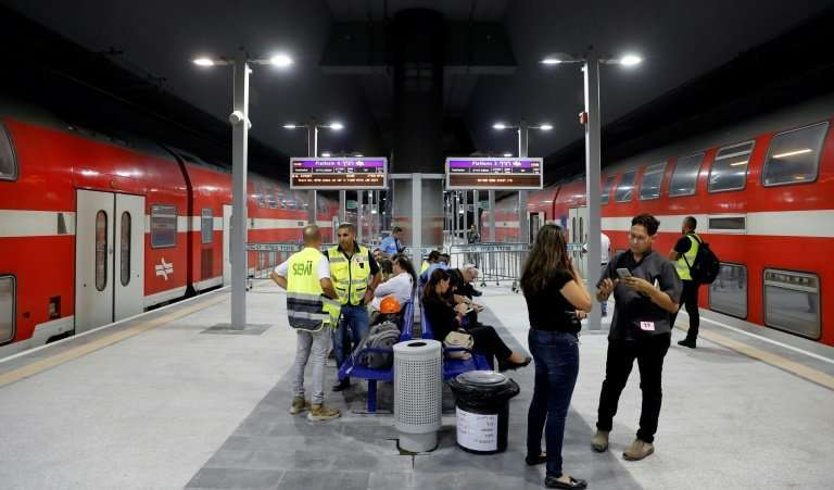 The red double-decker trains can carry up to 1,200 passengers but for now they are restricted to just 400 in a three-month trial