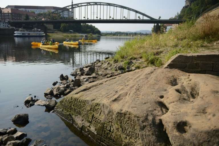"""The so-called """"Hunger Stone"""" embedded deep in the Elbe River has reappeared in the Czech Republic after Europe's long,"""