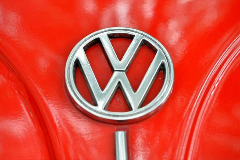 "The Volkswagen logo is seen on the bonnet of vintage Beetle. Mexican farming communities accused VW of ""arbitrarily"" p"