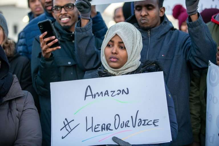 The workers timed their protest during the busy holiday shopping season, hoping to force the online retailer to make changes