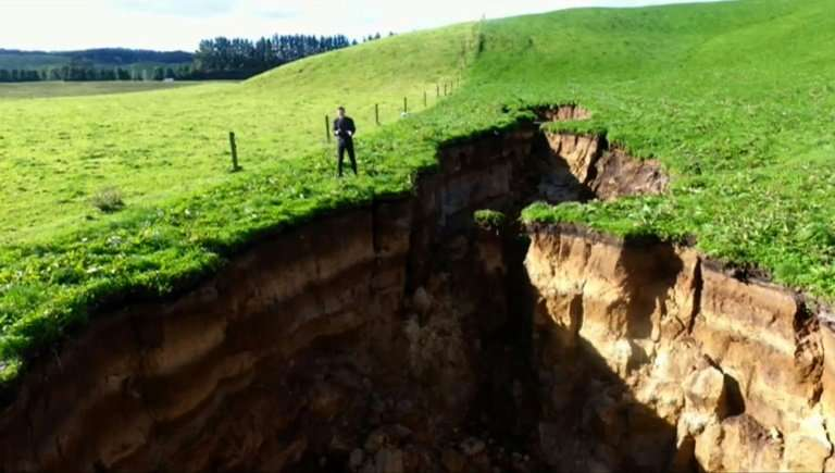 This frame grab from TVNZ video footage taken on May 2, 2018 and released to AFP on May 7 shows a sinkhole that appeared on a da
