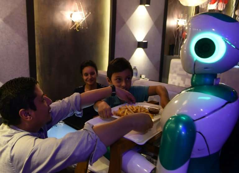 This humanoid robot named Ginger is one of three locally-built machines to serve customers at a restaurant in the capital of imp