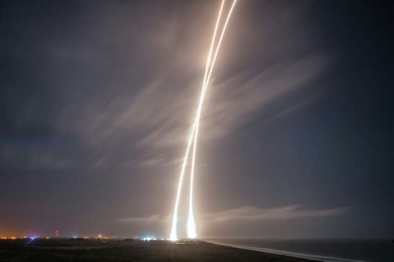 This image obtained courtesy of  SpaceX shows the first-stage successful upright launch and landing of the SpaceX  Falcon 9 rock