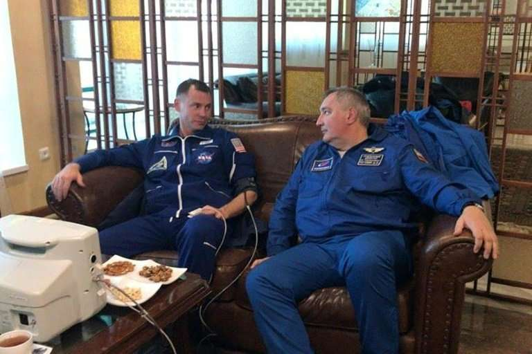 This October 11, 2018 picture posted on Twitter account of the Russian space agency Roscosmos shows US astronaut Nick Hague (L)