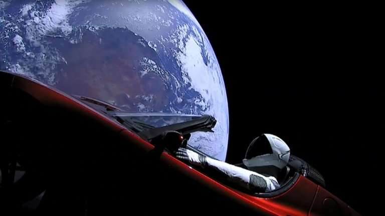 """This still image taken from a SpaceX livestream video shows """"Starman"""" sitting in SpaceX CEO Elon Musk's cherry red Tes"""