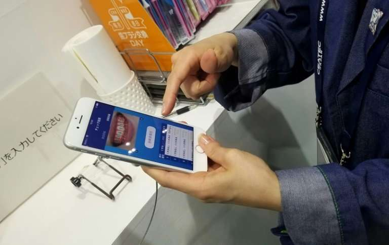 Using a device created by hygiene firm Lion, patients worried about their teeth can flash a smile at a smartphone and send it to