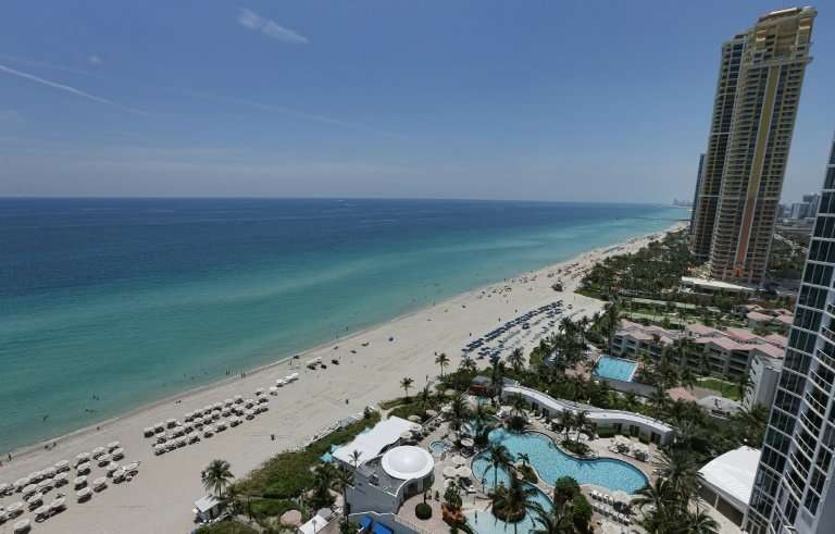 View of a beach from a condo building in Florida, where bitcoin fever has hit the real estate market