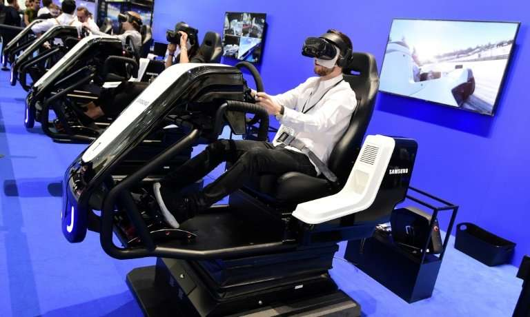 Visitors test virtual reality glasses at the 2018 IFA trade show in Berlin