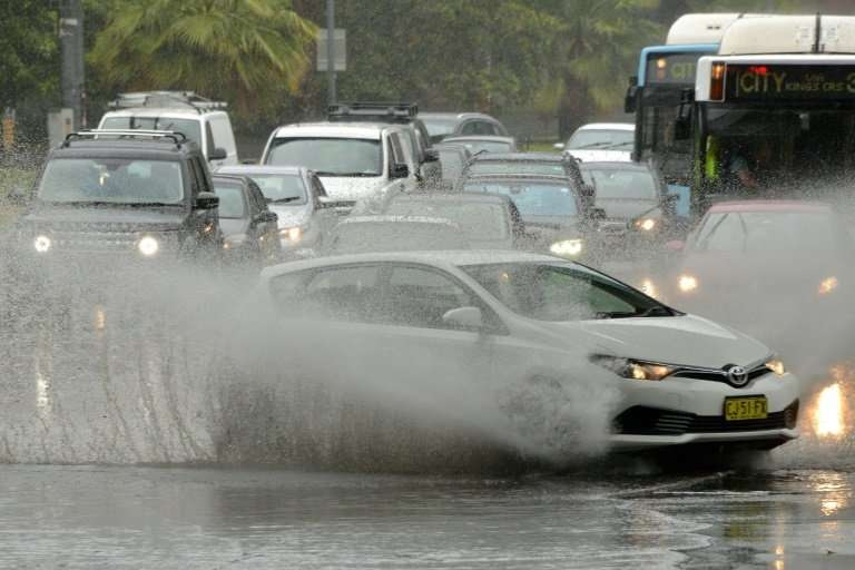 While Queensland battles bushfires and extreme temperatures, further south Sydney was hit by severe thunderstorms