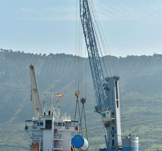 Wind turbine towers are loaded on a ship at Haizea Wind Group's headquarters at Bilbao's harbour