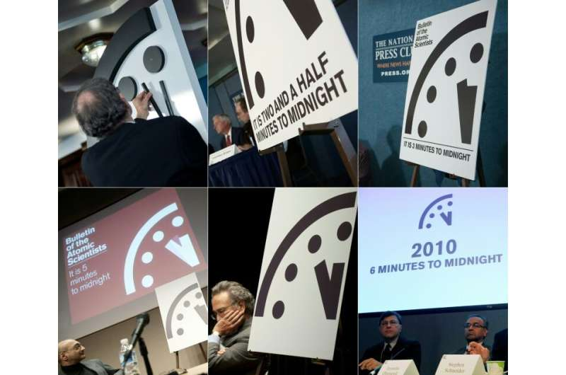 A combination of file pictures shows (clockwise from top L) the Doomsday Clock on January 25, 2018; on January 26, 2017; on Janu