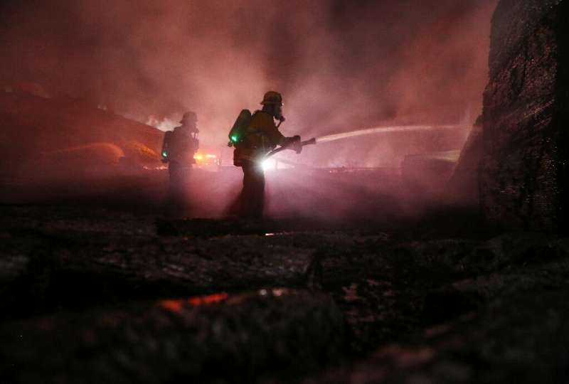 California's Tick fire broke out early Thursday afternoon, burning homes and structures and forcing the closure of a major highw
