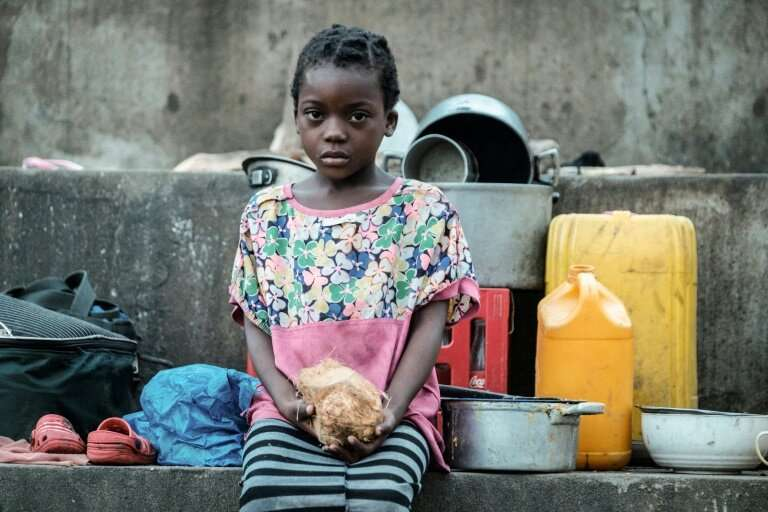 Elena Joaquin, 6, sits in a shelter in Buzi, Mozambique