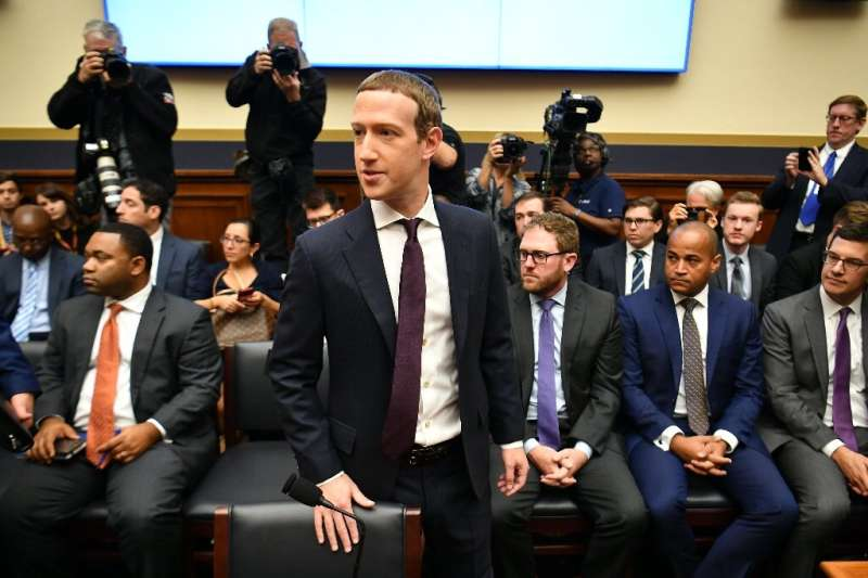 """Facebook Chairman and CEO Mark Zuckerberg arrives to testify before the House Financial Services Committee on """"An Examinati"""