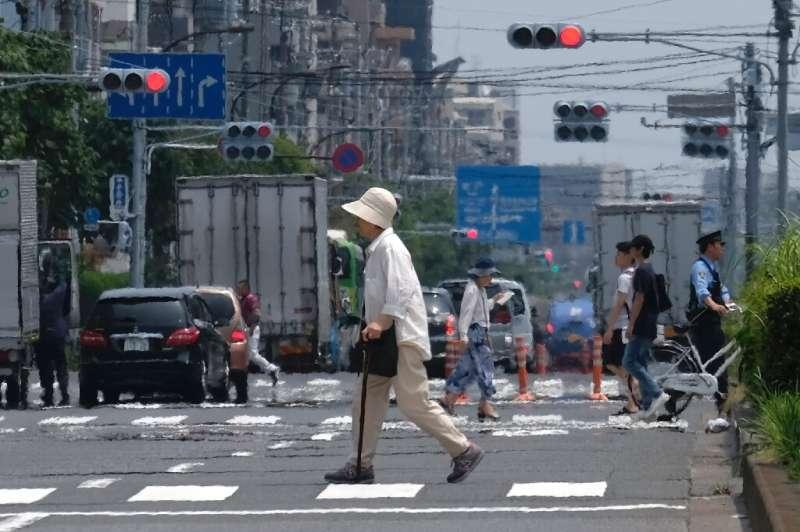 Heat haze distorts the background during a heatwave in Tokyo on July 31