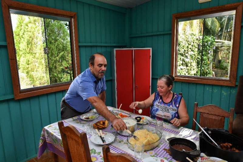 Luiz Medeiros dos Santos and his wife Maria have lunch at their farm in Ruropolis—they are proud of their efforts to preserve th