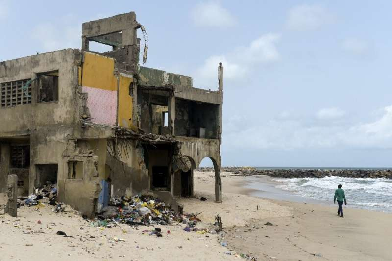 The shore-hugging Alpha Beach road has disappeared under the waves and apartment blocks built with prized ocean views just 10 ye
