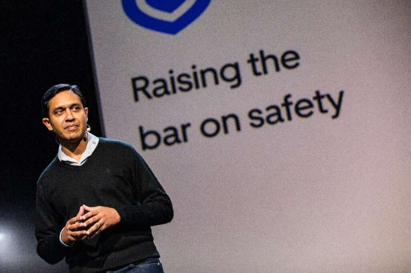 Uber safety product chief Sachin Kansal addresses the audience during an Uber product launch in San Francisco, discussing the up