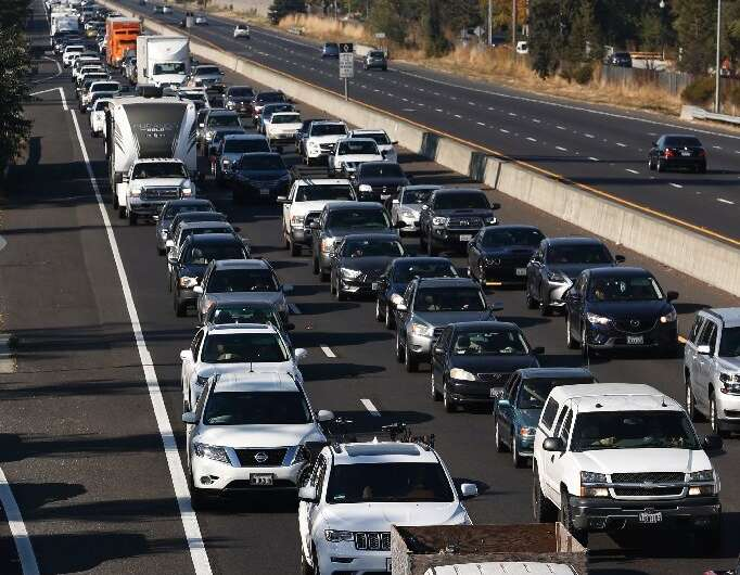 Vehicles travel south along Highway 101 as residents evacuate towns and cities because of the massive Kincade Fire in northern C