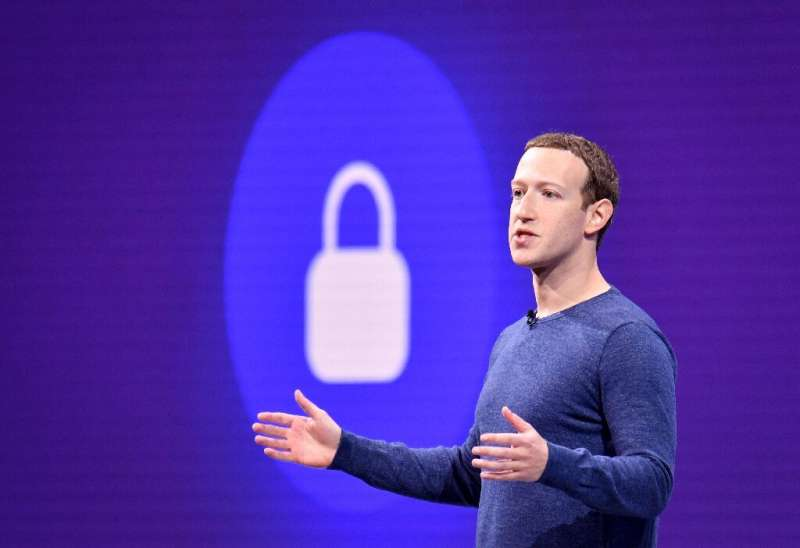 """Facebook CEO Mark Zuckerberg, seen in a 2018 picture, told employees recently the company would """"go to the mat"""" to cha"""