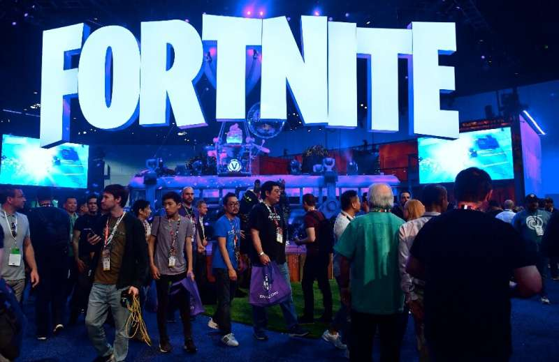 In this file photo taken on June 12, 2018, people crowd the display area for the survival game Fortnite at the 24th Electronic E