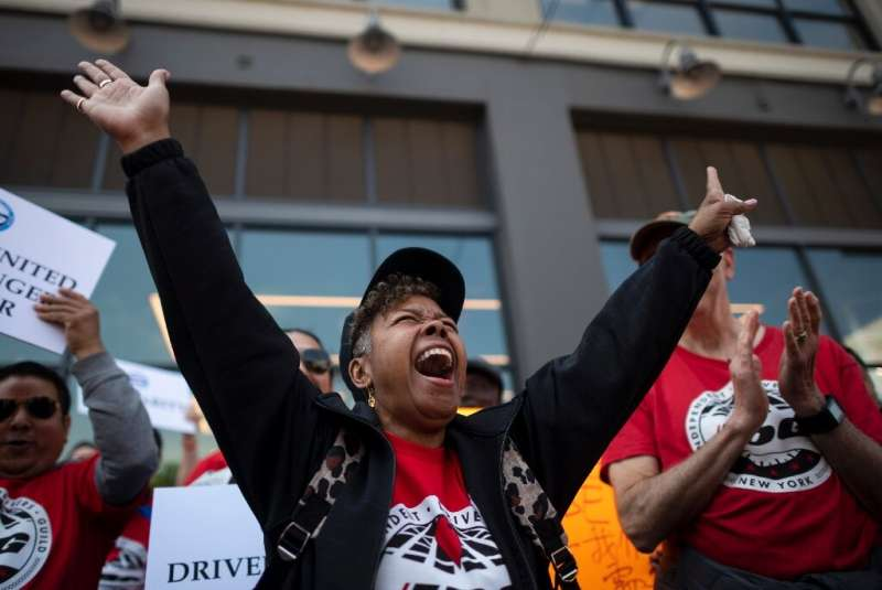 Members of the Independent Drivers Guild  rallied at Uber and Lyft headquarters in New York as part of a protest to press demand