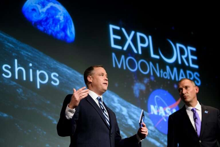 NASA Administrator Jim Bridenstine (L)—seen here at the US space agency's headquarters in November 2018—says the acceleration of