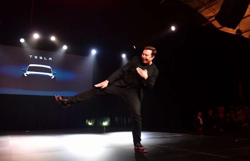 Tesla CEO Elon Musk, gesturing during unveiling of the new Tesla Model Y in March, 2019, is targeting production of a possible 5
