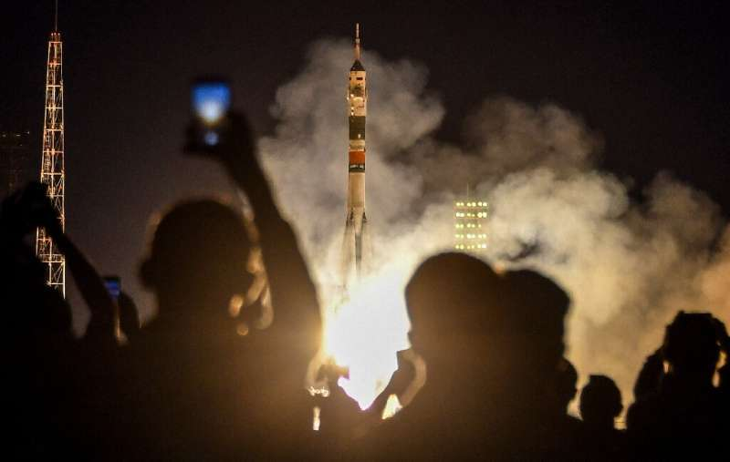 The Soyuz rocket carrying three crew members of the International Space Station blasts off