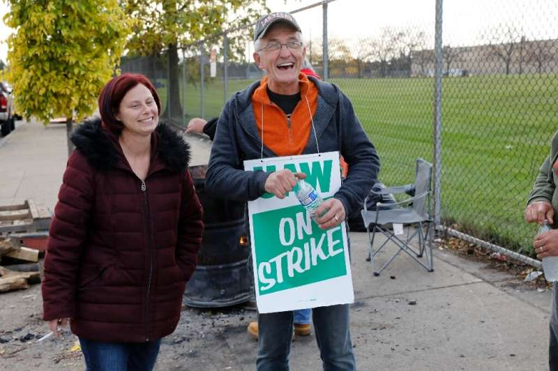 United Auto Workers (UAW) members Melissa Rose-Gorney and Nelson Worley, standing outside the GM Detroit-Hamtramck Assembly plan